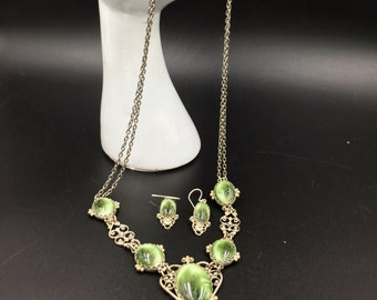 Beautiful Art Deco style Bib Necklace and matching earrings, Made with lite green cabs and set in a silver setting.