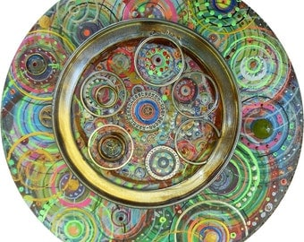 Abstract mixed media painting, metal parts, grommets, small round artwork, 6.5 inches on a wooden panel