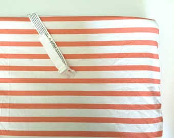 Coral and white stripped changing pad cover