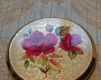 Vintage  Stratton powder compact depicting red Red Roses .