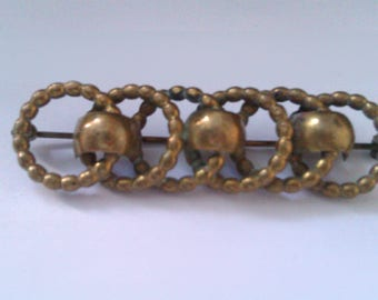 brass 5 loop bar brooch