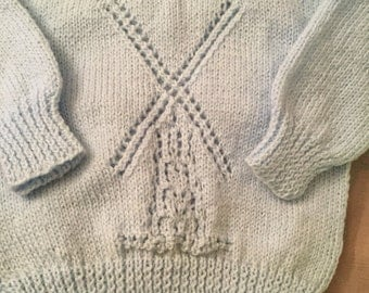 Baby boys hand knit jumper with windmill design on front.  3 button back fastening baby blue made in Ireland