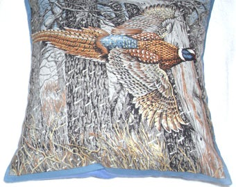 low flying Pheasant by winter woods cushion
