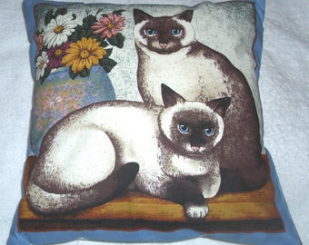 Beautiful cream and white cats with vase cushion