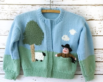 Vintage Handmade Knit Childrens' Cardigan Sweater in Spring Colors - Blue Sky, Lamb, and Farmer Doll in Front Pocket