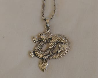 Sterling silver dragon pendant and silver chain,