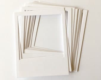 10 white card instant camera style frames for scrapbooks, smashbooks and journals.