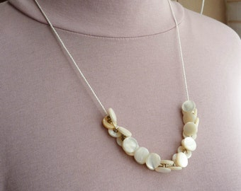 Cream colored necklace with small, vintage, shell buttons