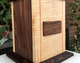 Funeral urn in maple wood and solid black walnut