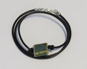E-1787 Black Leather Bracelet with Sterling Silver Clasp and Turquoise/Tan Ceramic Bead
