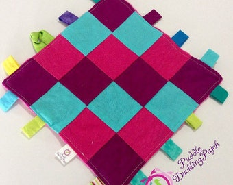 Minky baby Tag blanket: Baby Girls Pink and blue cotton and Minky blanket.
