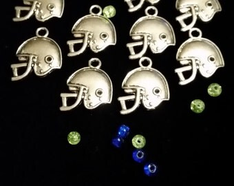 15 antique silver finish helmet charms. Buy 2 lots get 1 FREE!! .