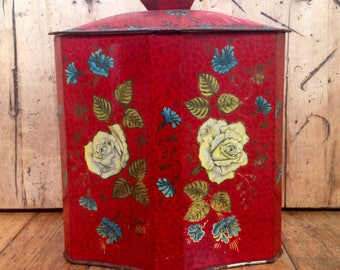 Red toffee tin with yellow roses made in England