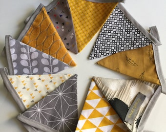 pennants/flags in gray and yellow tissue Garland