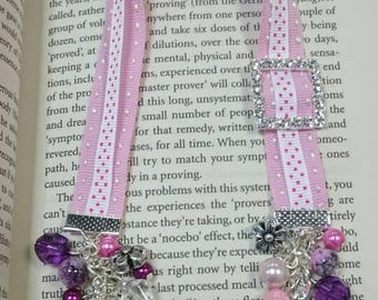 Pink and white ribbon bookmark with beads and butterfly charm