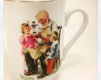 Norman Rockwell Porcelain Cup Seal Of Authenticity 1982 22k gold trim The Toymaker