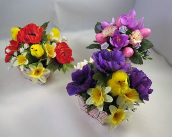 Easter posy arrangements, in assorted colours with  Easter chicks and eggs.