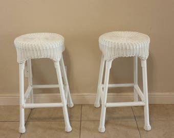 All weather resin wicker over a powder coated steel frame bar stools pair