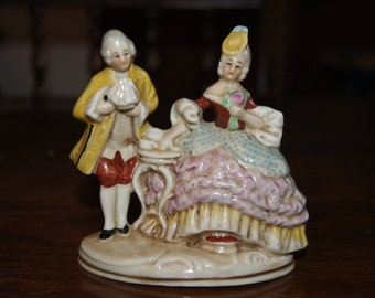 Hand-painted Ornament of an Eighteenth-Century Couple.