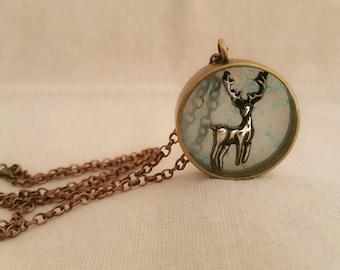Deer necklace.