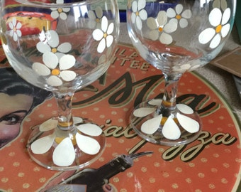 Set of two hand painted daisy wine glasses