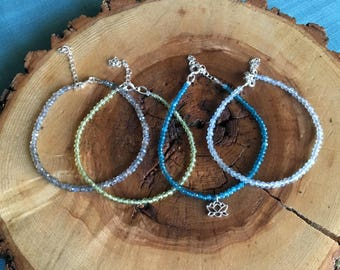 Faceted Beaded Bracelets; Premium gemstones: Labradorite, Peridot, Apatite, Aquamarine micro-faceted gems, sterling silver, optional charm