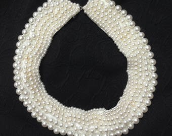 C1950s beaded white pearl collar complete on satin approx 15 inches. Clothes accessory or wear on own as choker necklace.