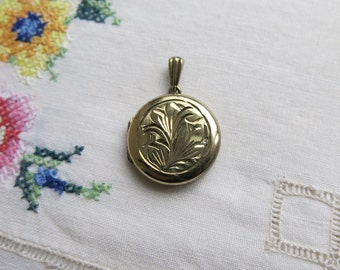 Vintage gold on silver round etched locket