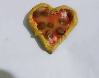 Heart shaped Pepperoni pizza w/ chess and sauce