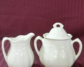 Antique Royal Staffordshine pottery sugar and creamer set.
