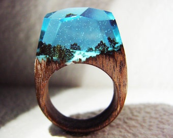 """Geppetto Jewelry presents: Game of thrones jewelry. Wood ring """"Winterfell"""".  Resin wood ring. Secret world in wooden rings for women & men."""