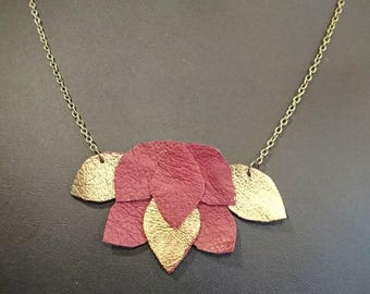 Foliage, leather, red and gold necklace.
