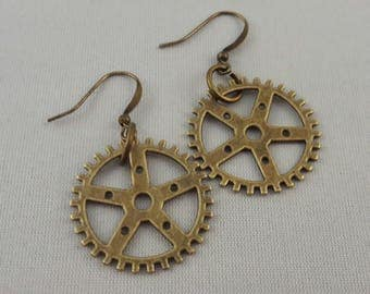Pair of bronze gear earrings,