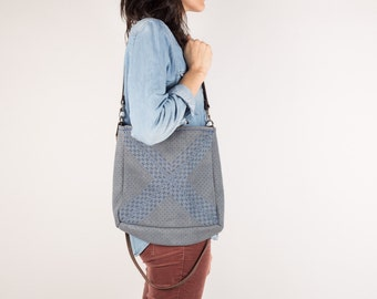Medium size embroidered leather hand bag