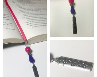 "Genuine leather bookmark with ""memories"" charm."