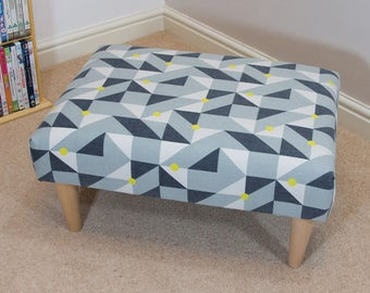 Footstool with puzzle geometric fabic