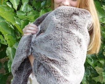 Faux bear fur wrap with champagne lining