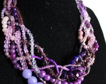 Necklace neckline with pearls, beads, crystals and semiprecious stones entwined purple