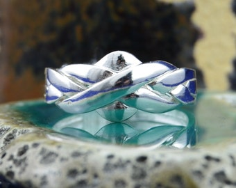4 piece Sterling Silver Puzzle Ring in sizes 6, 7, 8, 9, 10, 11, 12