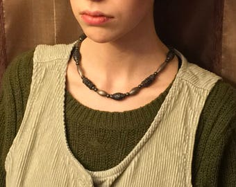 Metal beaded necklace. Has a bohemian feel to it.