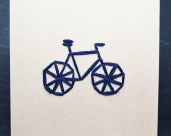 Blue Racing Bike on Brown Card