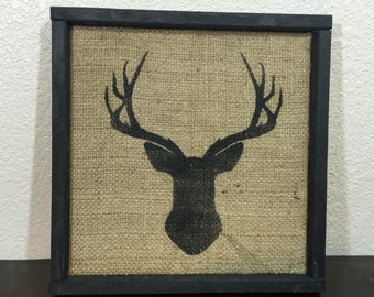 """Deer silhouette on reclaimed burlap sign with rustic shadow-box style frame 13.5""""x13.5"""""""
