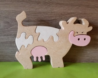 Cow puzzle in massive beech wood
