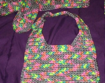 Crocheted baby bib, booties, and bennie