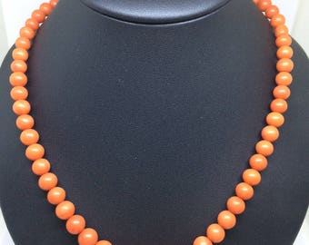 A graduated coral bead necklace