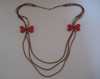 Network-hot butterfly. Necklace duo butterflies red.