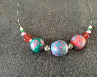 Green, red, purple and silver wire necklace