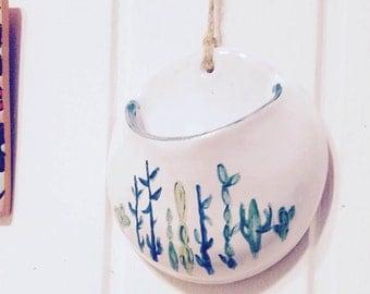 Handmade pottery plant pot.