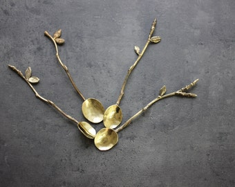 Handmade spoon from brass  with  leaves