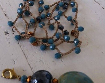 Long necklace with crystals and detachable ceramic pendant